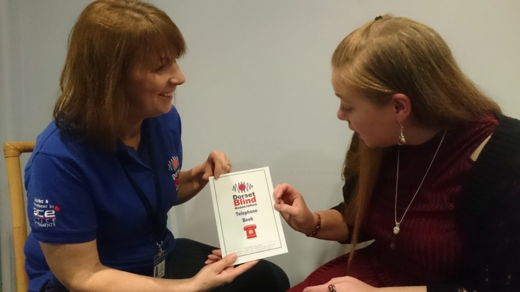 Community Support Worker, Bev, helps one of our members
