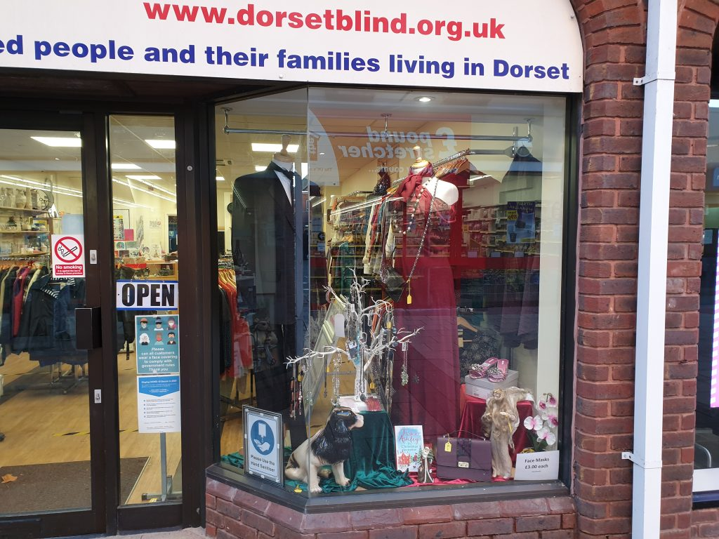 Picture of shop front in Christchurch showing festive evening wear