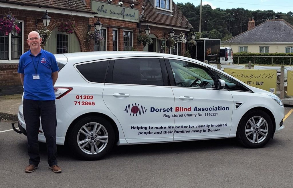 Picture of Equipment co-ordinator Jim Logan with his DBA vehicle