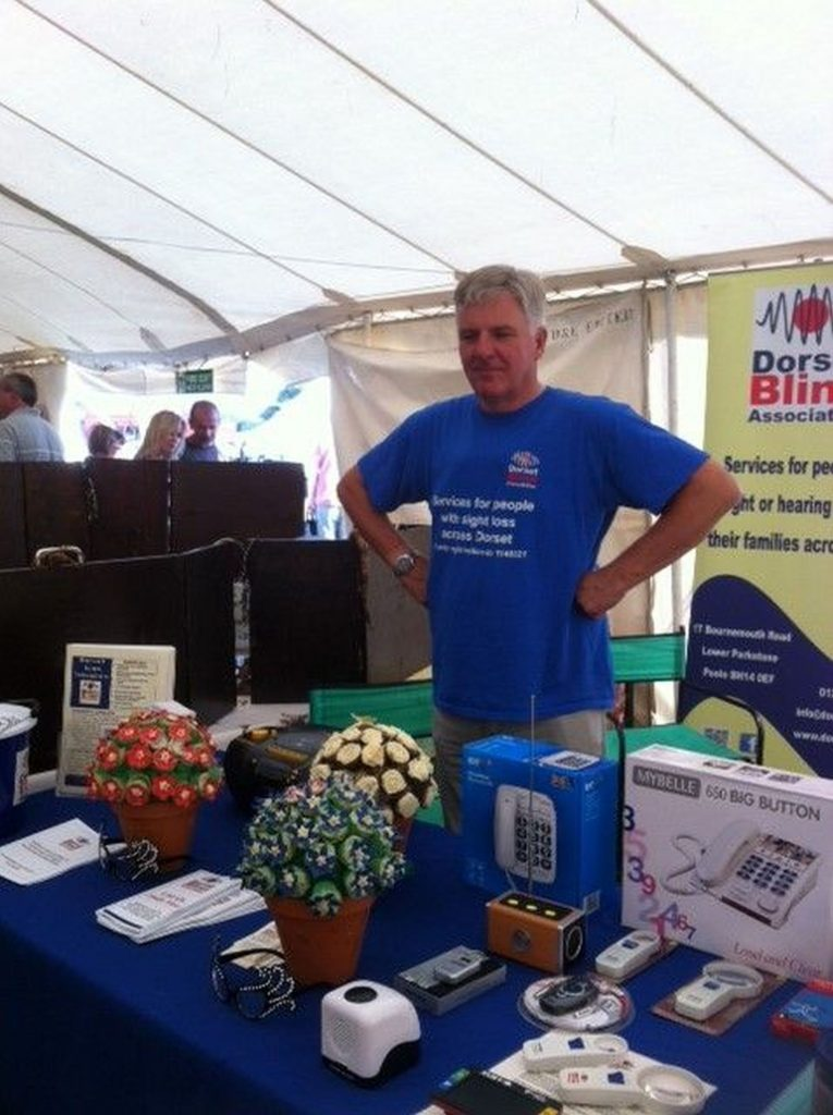 A photo of our trustee Martin Dowley at a fundraising event