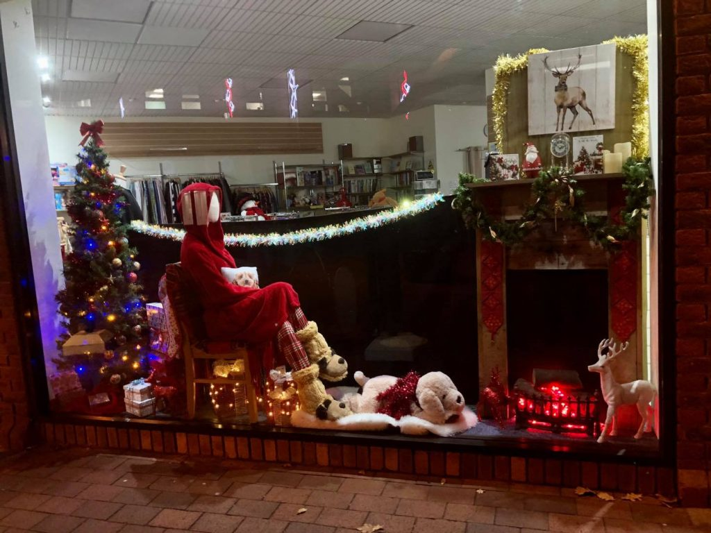 Picture shows a festive fireplace scene in the shop window